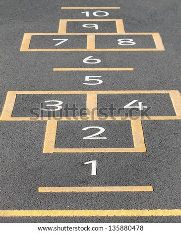 Hopscotch game painted on a school playground. - stock photo