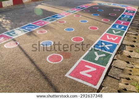 hopscotch on asphalt outdoors - stock photo