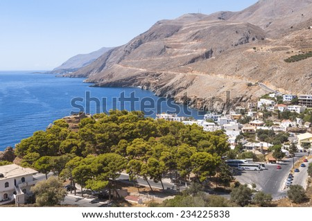 HORA SFAKION, GREECE - SEPTEMBER 15. Top view to the village Hora Sfakion on September 15, 2014. Hora Sfakion is located on the south coast of Crete. The starting point for hiking in the Lefka Ori - stock photo