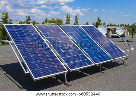 HORISHNI PLAVNI, UKRAINE - Solar panels on the roof of a dwelling house in the afternoon