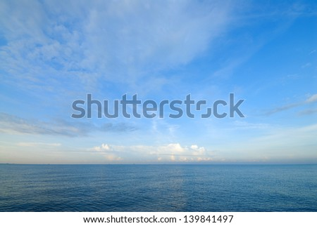 Horizon line between sky and sea water