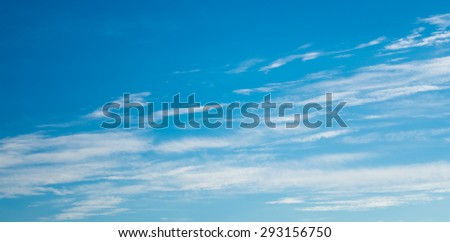 horizontal arrangement of abstract clouds in a blue sky - stock photo