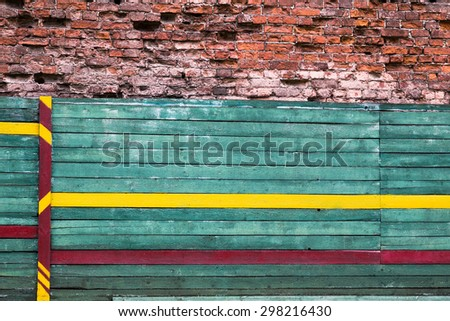 horizontal background from cracked bricks and painted wooden board - stock photo