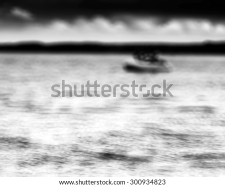 Horizontal black and white boat on lake bokeh background