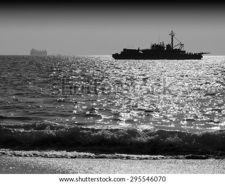 Horizontal black and white ship silhouette with tidal waves background backdrop
