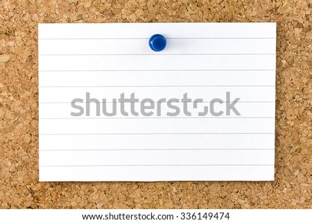 Horizontal Blank white striped sheet fixed on cork board with a blue small thumb tack - stock photo