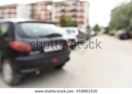 Horizontal blurred closeup photo shoot of parked cars, outdoors on the street,  - stock photo