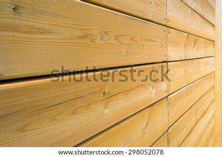 Horizontal boards in sunlight in summer