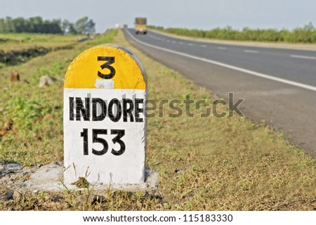 Horizontal capture of 153 kilometers to Indore Milestone on the National Highway 3 from Bombay to Indore, the Agra Road, India - stock photo