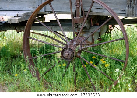 Horizontal closeup of an iron wagon wheel in ghost town in Oregon, USA.