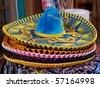 Horizontal closeup photo of details of Mexican sombrero hat - stock photo