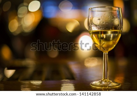 horizontal color image of wine glass and lights - stock photo