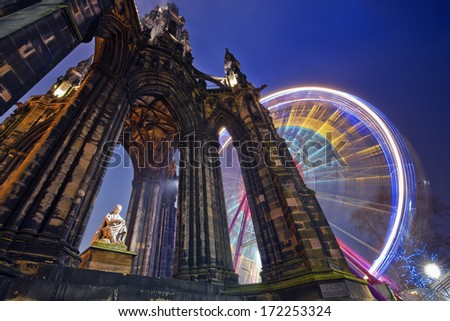 Horizontal colour image of Scott Monument and russian wheel in the background, Edinburgh, Scotland - stock photo