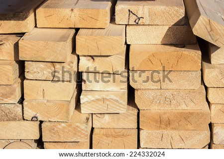 horizontal composition filled with slabs of lumber. - stock photo