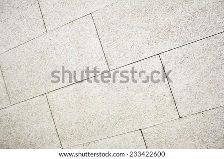 Horizontal cream tiles on urban land, construction - stock photo
