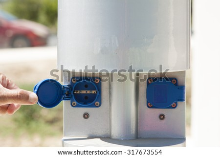 horizontal electric charger for green cars  - stock photo