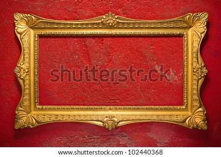 Horizontal golden frame on red, grunge garage wall, inner and outer clipping paths included - stock photo