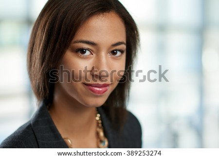 Horizontal headshot of an attractive african american business woman shot with shallow depth field. - stock photo