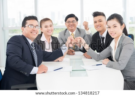 Horizontal image of a business team smiling and looking at camera
