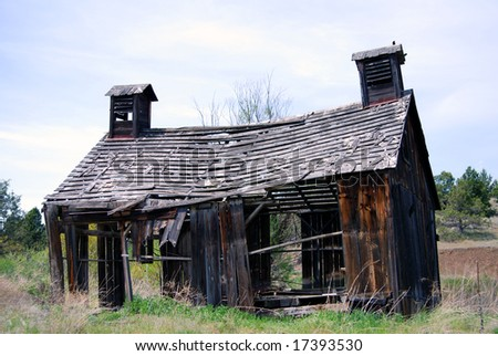 Horizontal image of a derelict 1900's barn in ruins, in Oregon, USA. - stock photo
