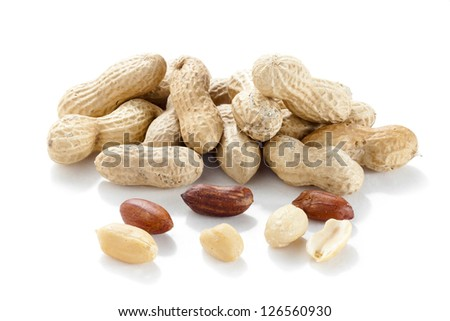 Horizontal image of a pile of fresh ground nuts isolated on a white background