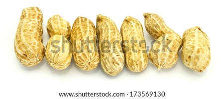 Horizontal image of a pile of fresh ground nuts isolated on a white background - stock photo