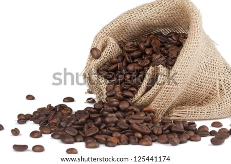 Horizontal image of a sack with a spilled coffee beans on a white background