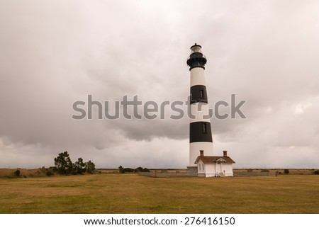 Horizontal image of Bodie Island Lighthouse on cloudy day.  Cape Hatteras National Seashore, Outer Banks, North Carolina. - stock photo