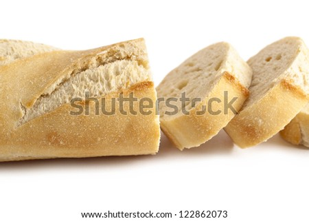 Horizontal image of fresh slices of bread lying over the white background