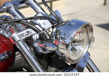 Horizontal image of the front of a motorcycle including the headlight.