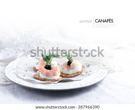 Horizontal image of Tiger prawn, caviar and cream cheese canapes in a vintage setting against a white, bright background. A perfect image for your wedding breakfast cover design. Generous copy space. - stock photo