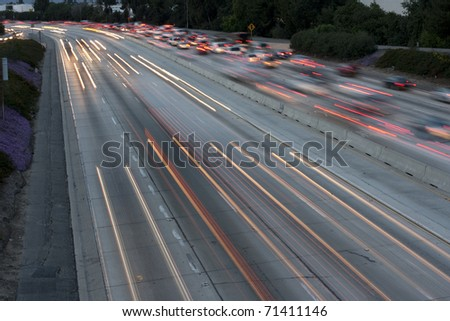 Horizontal long exposure image of the 405 Freeway in Los Angeles in the early evening. - stock photo