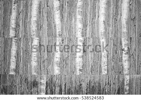 Horizontal marble tiles urban wall construction