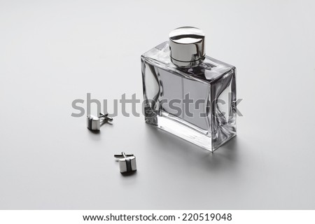 Horizontal mens cologne and cuff links monochrome - stock photo