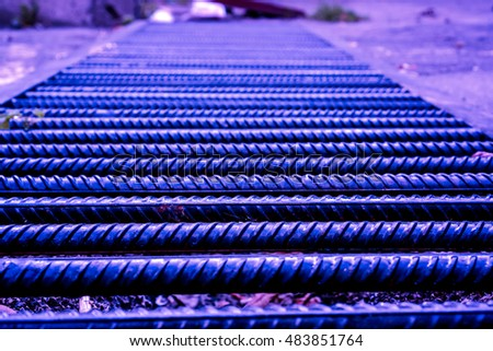 horizontal metal bar as road, violet metal rusty bars as stairs against grey background, metal bar with rusty as texture, rusty armature for building against cement concrete, high resolution