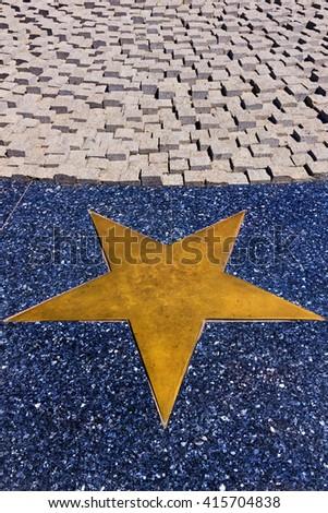 Horizontal metal star on marble design - stock photo