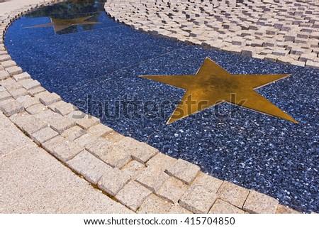 Horizontal metal stars path on marble design - stock photo