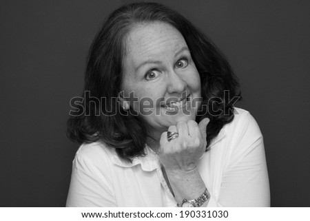 horizontal orientation close up in black and white of a single woman with a happy, excited look on her face / Enthusiastic Employee - stock photo