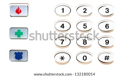 horizontal orientation close up of security keypad and symbols for fire, first aid and police with plenty of white copy space / Protection begins at Home - stock photo