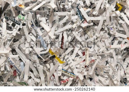 horizontal orientation close up of shredded paper, with copy space / Shredded Documents - Horizontal - stock photo