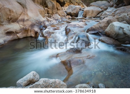 horizontal orientation color image of waterfalls on the South Saint Vrain Creek in Roosevelt National Forest, with slow shutter speed to capture the movement of water/ Beautiful Colorado Waterfalls - stock photo