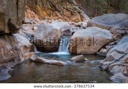 horizontal orientation image of waterfalls on the South Saint Vrain Creek in Colorado / South Saint Vrain Creek waterfalls - with slow shutter speed - stock photo