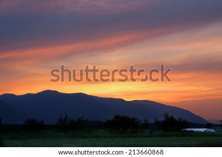 horizontal orientation in high dynamic range (HDR) of sunset over the Selkirk Mountain Range in northern Idaho, USA / Sunset over the Selkirks - stock photo