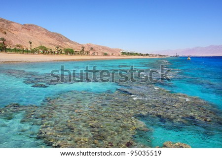 Horizontal oriented image of beautiful view on Red Sea and shoreline at popular touristic resort of Eilat, Israel. - stock photo