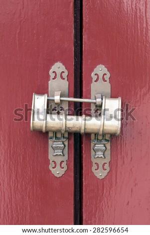 horizontal padlock on wooden door - stock photo