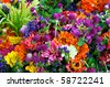 Horizontal photo of large group of summer flowers at farm market - stock photo