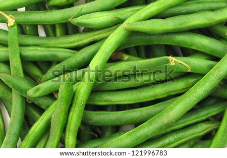 Horizontal photo of pile of just harvested green beans at farm market