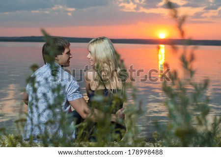 horizontal photo the  happy  couple, outdoor on sunset or sunrise, romantic date - stock photo