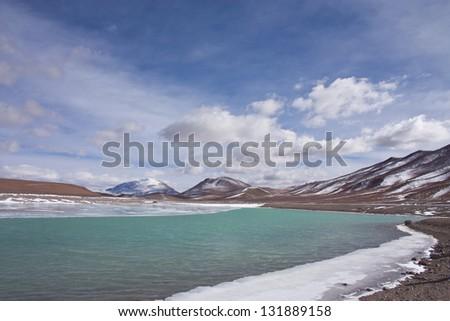 Horizontal photography of the icy shore of the Lake on Route 27, Paso Jama, on the way to Salar de Tara - Atacama Desert - Chile - stock photo