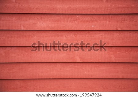 horizontal picture of  horizontal planks with bright red paint - stock photo